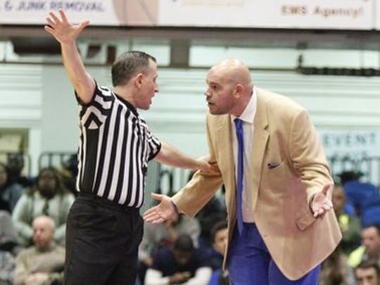 Saunders coach Anthony Nicodemo talks to an official during his team's 59-41 loss to Mount Vernon in the Class AA semifinals at the Westchester County Center in 2016.