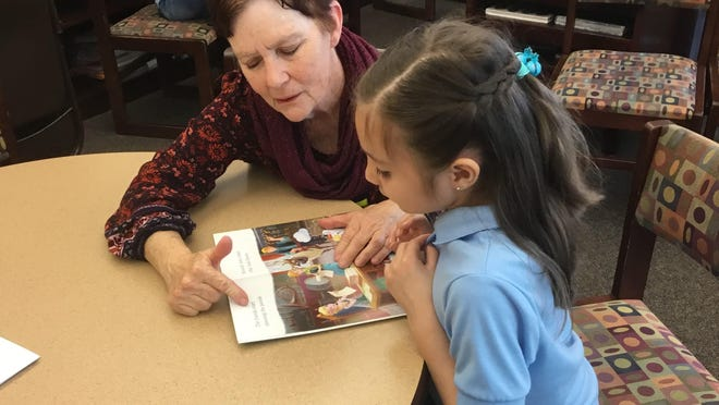 The local Team First Book nonprofit works to give students a new book for the first time.
