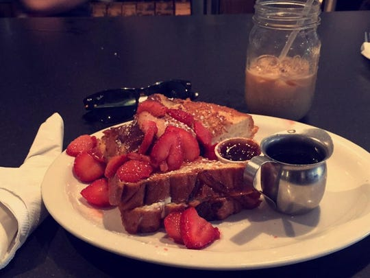Challah-stuffed French toast filled with sweetened cream cheese and topped with sliced strawberries at Toast in Asbury Park.