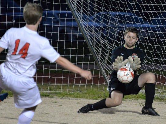 Oakland goalkeeper Jakob Hurst stops Jonathan Sneed's