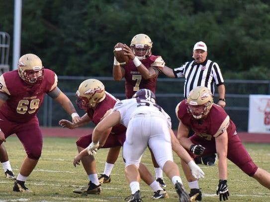 Riverdale quarterback Christian Souffrant takes a snap