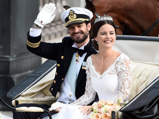 Sweden's Prince Carl Philip sits with his bride, Sofia