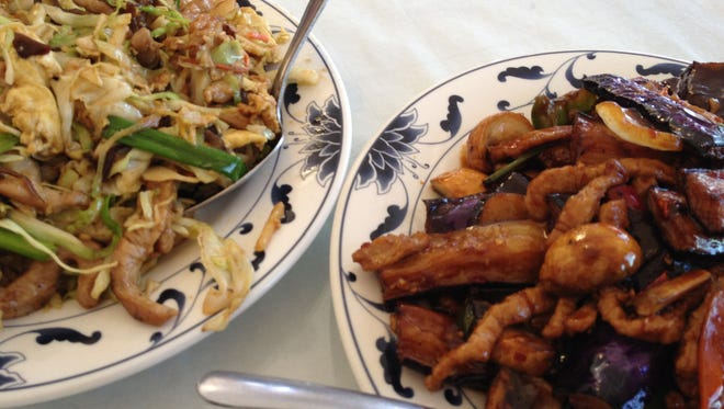 Moo shu pork, left, and eggplant with pork and garlic sauce, both $8.99, are among the house specials at China Kitchen in northwest Reno.