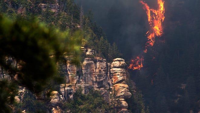 The slide fire burns near 89 A south of Flagstaff, Arizona on Wednesday.