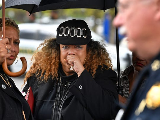 Godmother of DeEbony Groves, who refused to give her name, cries as she listens to  Chief of Police Steve Anderson talk to the media at a press conference after Waffle House shooting suspect Travis Reinking was captured. Monday April 23, 2018, in Nashville, Tenn
