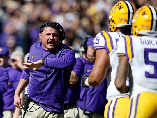FILE - In this Nov. 19, 2016, file photo, LSU interim head coach Ed Orgeron works the sideline during an NCAA college football game against Florida in Baton Rouge, La. Florida won 16-10 after the Gators stopped LSU's Derrius Guice (5) at the goal line on the final play of the game. Hurricane Matthew's football fallout concludes Saturday, when reeling LSU plays at 21st-ranked Florida in a game that was switched from Baton Rouge to Gainesville. (AP Photo/Gerald Herbert, File)