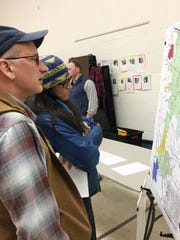 Huntington resident and backcountry skier Joe Perella studies a map that charts future recreational use in Camels Hump State Park during a public meeting on Wed., Nov. 15, 2017.
