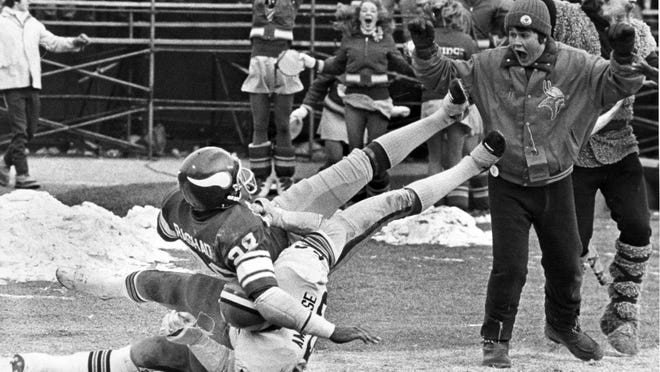 Minnesota Vikings receiver Ahmad Rashad, top, tumbles into the end zone with the winning touchdown after being tackled by Cleveland Browns' Dick Ambrose on Dec. 14, 1980, in Bloomington. The Vikings' Tommy Kramer connected with Rashad on a deflected 46-yard completion to give the Vikings a 28-23 victory over Cleveland to clinch their 11th division title in 13 years.