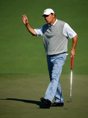 In a file photo from 2014, Augusta marker Jeff Knox waves to the crowd at the  Masters.