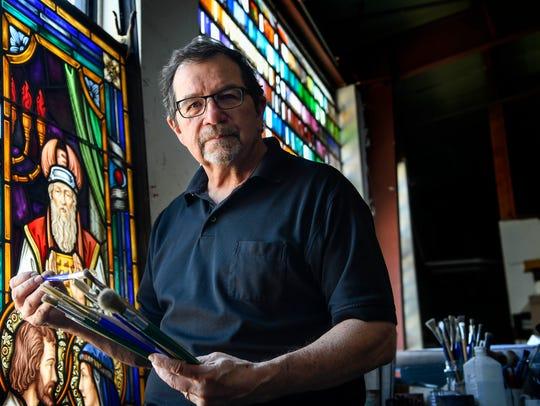 Dennis Harmon, president of Emmanuel Studio, Inc. poses