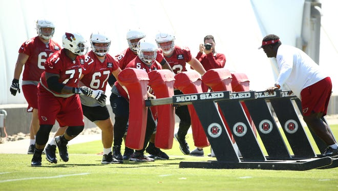 Arizona Cardinals offensive linemen Andre Smith (71), Justin Pugh (67) and A.Q. Shipley (53) during voluntary Organized Team Activities on June 7, 2018 at the Arizona Cardinals Training Facility in Tempe, Ariz.