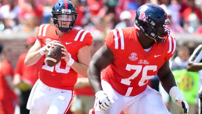 Shea Patterson (20) set a single-game Ole Miss record with 489 passing yards on Saturday.