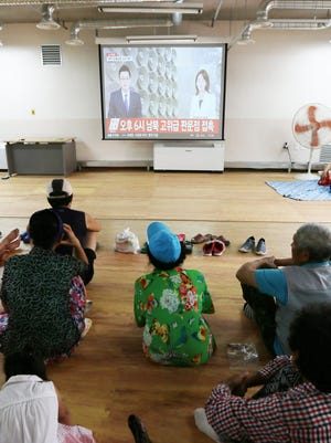 People watch a television news report of inter-Korean high-level talks at a shelter on Yeonpyeong Island, South Korea near the western maritime border with North Korea, on Aug. 22, 2015.