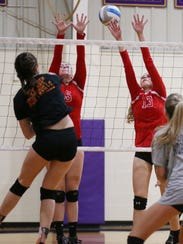 Jumping up for a block during Monday's scrimmage are