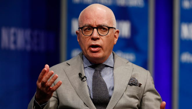FILE - In this April 12, 2017, file photo, Michael Wolff of The Hollywood Reporter speaks at the Newseum in Washington. Wolff used to worry about the spotlight moving on. No longer. The author of an explosive book on President Donald Trump's administration is the target of a cease and desist letter from Trump's lawyers. And he's the focus of a campaign by the president's allies to cast doubt on the book's claim that Trump is a reluctant and troubled president.