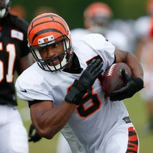 Cincinnati Bengals tight end Alex Smith runs the ball after a reception during training camp downtown. Smith went on IR Tuesday. The Enquirer/Jeff Swinger