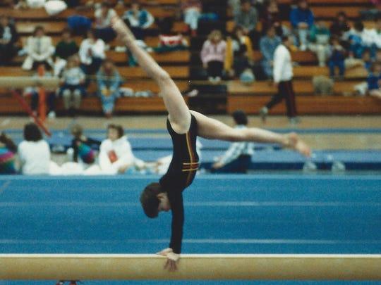 Sara Faculak Teristi performs on a balance beam in