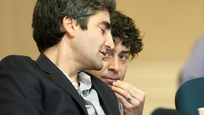 Burlington Mayor Miro Weinberger (left) speaks to his chief of staff Mike Kanarick at a City Council meeting in November 2013 at Contois Auditorium.