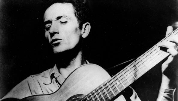 This undated file photo shows folk singer Woody Guthrie