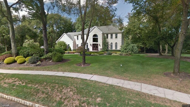 This Google Street View image shows the approximate location of 20 Gramercy Lane in Manalapan. The property at this address changed hands in June 2019, when  Konstantin Shaporov  and  Liliy Shaporova   bought the property from  Bauman,Ira M & Michele, Trustees  for $815,000.