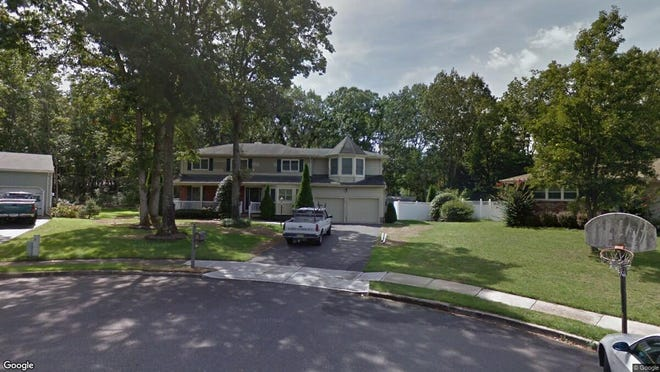 This Google Street View image shows the approximate location of 12 Huntington Court in Toms River. The property at this address changed hands in April 2019, when John and Tamara N Graham  bought the property from  Gary B Angelo  for $430,000.