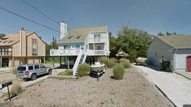 This Google Street View image shows the approximate location of 19 Beach Drive in Little Egg Harbor. The property at this address changed hands in May 2019, when Bernardo and Mercedes Suarez  bought the property from  Maureen L Mooney  for $142,300.