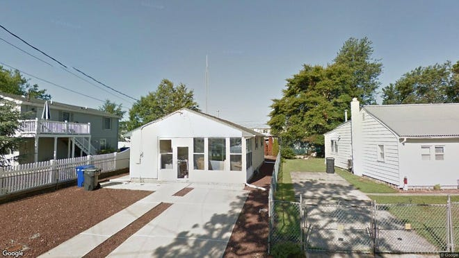 This Google Street View image shows the approximate location of 582 Wood St{dot} in Toms River. The property at this address changed hands in May 2019, when Antonia and Giovanna Depinto  bought the property from Edward M and Nancy A Napolitano  for $158,000.