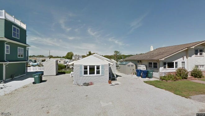 This Google Street View image shows the approximate location of 109 E. Boat Drive in Little Egg Harbor. The property at this address changed hands in June 2019, when David Colalillo bought the property from Fernando Gonzalez III for $170,000.