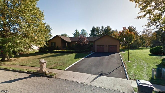 This Google Street View image shows the approximate location of 18 Escher Drive in Marlboro. The property at this address changed hands in May 2019, when Evgeny and Bella Elogoodin  bought the property from Henrich and Lyubov Chigirinsky  for $598,500.