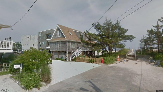 This Google Street View image shows the approximate location of 209 E. S. 33rd St. in Long Beach Township. The property at this address changed hands in May 2019, when Selman, Jonathan D 2017 Trust bought the property from Sally Q Mason and others for $1,580,000.