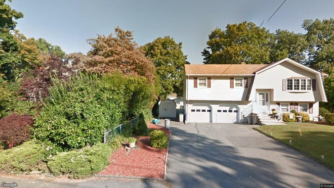 This Google Street View image shows the approximate location of 42 Oak Ave. in Pequannock. The property at this address changed hands in April 2019, when Eric Glenn and Johanna Mary Kubichek bought the property from Elaine Philbin for $452,500.