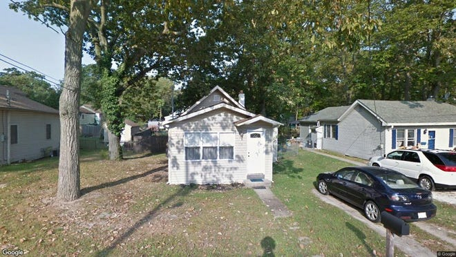 This Google Street View image shows the approximate location of 108 Walnut Lane in Pine Hill. The property at this address changed hands in May 2019, when new owners bought the property for $52,900.