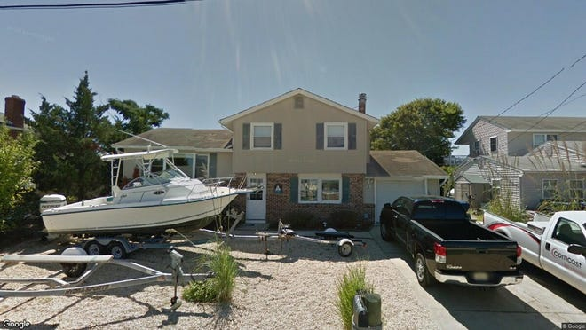 This Google Street View image shows the approximate location of 118 E. Navasink Drive in Little Egg Harbor. The property at this address changed hands in June 2019, when new owners bought the property for $185,000.