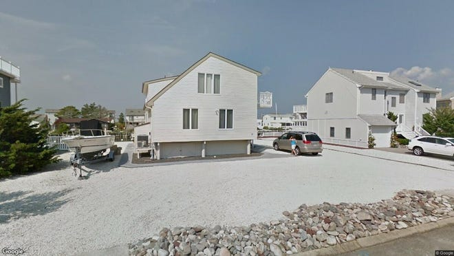 This Google Street View image shows the approximate location of 18 Meadow Lane in Long Beach Township. The property at this address changed hands in August 2019, when new owners bought the property for $715,000.