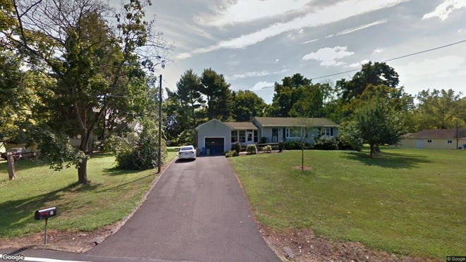 This Google Street View image shows the approximate location of 54 E. Mountain Road in Hillsborough. The property at this address changed hands in June 2019, when new owners bought the property for $332,000.