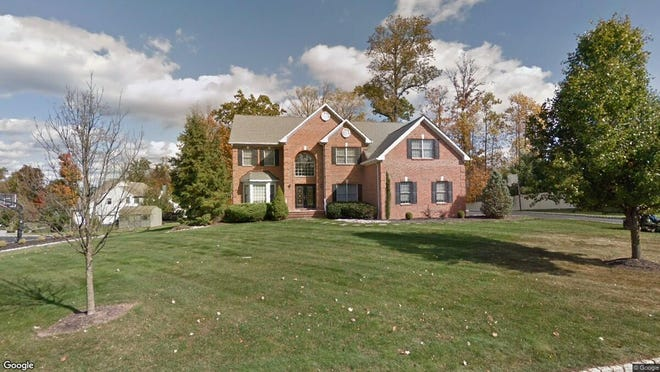 This Google Street View image shows the approximate location of 52 Briarwood Drive E. in Warren. The property at this address changed hands in July 2019, when new owners bought the property for $970,000.