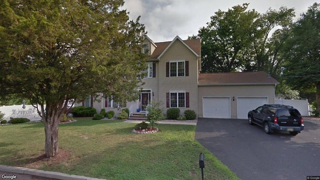 This Google Street View image shows the approximate location of 712 Manor Drive in Brick. The property at this address changed hands in July 2019, when new owners bought the property for $414,900.
