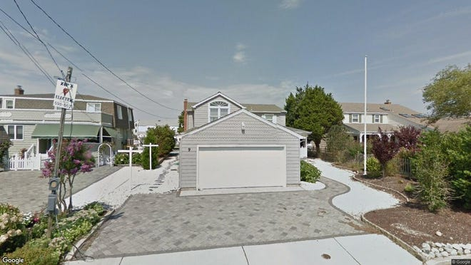 This Google Street View image shows the approximate location of 9 W. Dune Lane in Long Beach Township. The property at this address changed hands in August 2019, when new owner bought the property for $975,000.