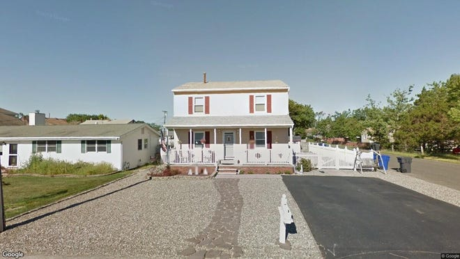 This Google Street View image shows the approximate location of 72 Wood Haven Road in Toms River. The property at this address changed hands in September 2019, when new owners bought the property for $310,000.