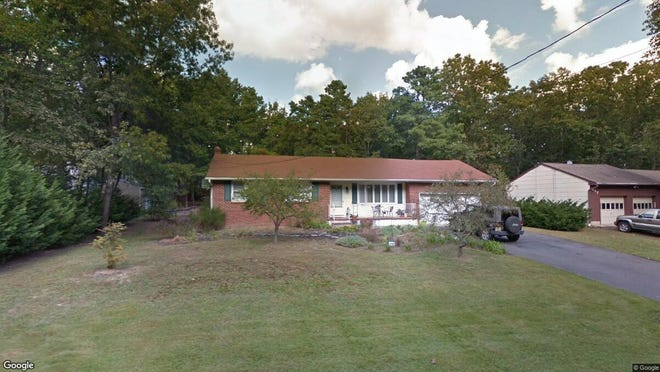 This Google Street View image shows the approximate location of 215 Lake Shore Drive in Evesham. The property at this address changed hands in August 2019, when new owners bought the property for $235,000.