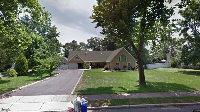This Google Street View image shows the approximate location of 12 Stratford Drive in Freehold Township. The property at this address changed hands in October 2019, when new owners bought the property for $480,000.