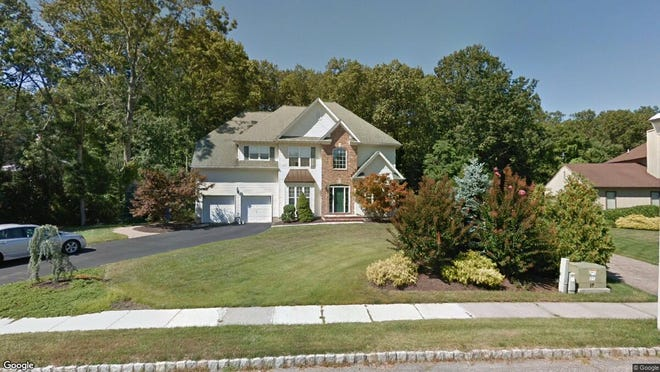 This Google Street View image shows the approximate location of 663 Winding River Road in Brick. The property at this address changed hands in August 2019, when new owners bought the property for $503,000.