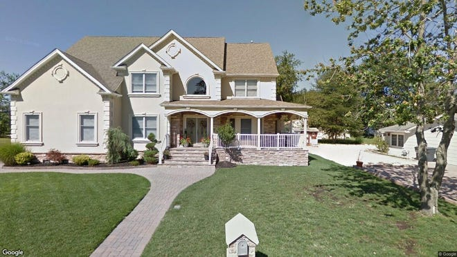 This Google Street View image shows the approximate location of 103 Tiller Drive in Toms River. The property at this address changed hands in October 2019, when new owners bought the property for $520,000.
