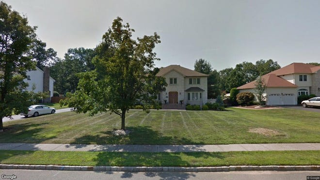 This Google Street View image shows the approximate location of 5 Woodhollow Drive in Manalapan. The property at this address changed hands in October 2019, when new owners bought the property for $649,900.