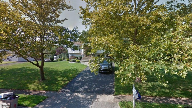This Google Street View image shows the approximate location of 9 Farm Tree Road in Manalapan. The property at this address changed hands in August 2019, when new owner bought the property for $495,000.