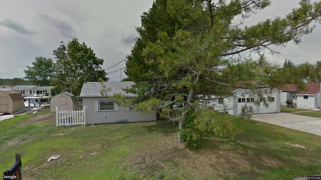 This Google Street View image shows the approximate location of 11 Compass Road in Waretown. The property at this address changed hands in October 2019, when new owners bought the property for $235,000.