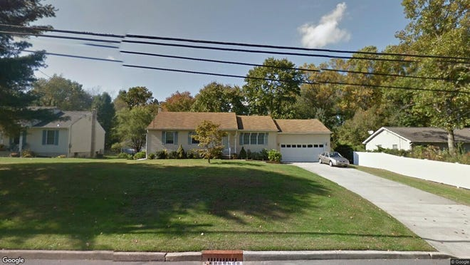 This Google Street View image shows the approximate location of 209 County House Road in East Greenwich. The property at this address changed hands in June 2019, when new owners bought the property for $190,000.