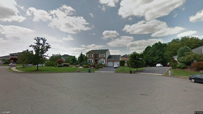 This Google Street View image shows the approximate location of 1 Ike Court in Marlboro. The property at this address changed hands in November 2019, when new owners bought the property for $645,000.