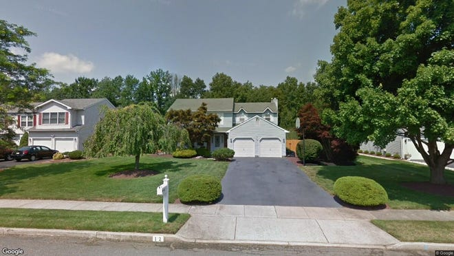 This Google Street View image shows the approximate location of 12 Newport Drive in Manalapan. The property at this address changed hands in November 2019, when new owners bought the property for $565,900.