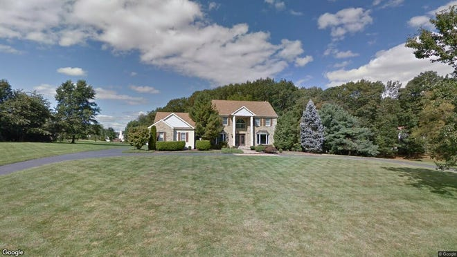 This Google Street View image shows the approximate location of 4 Maple Knoll Lane in Manalapan. The property at this address changed hands in November 2019, when new owners bought the property for $635,000.